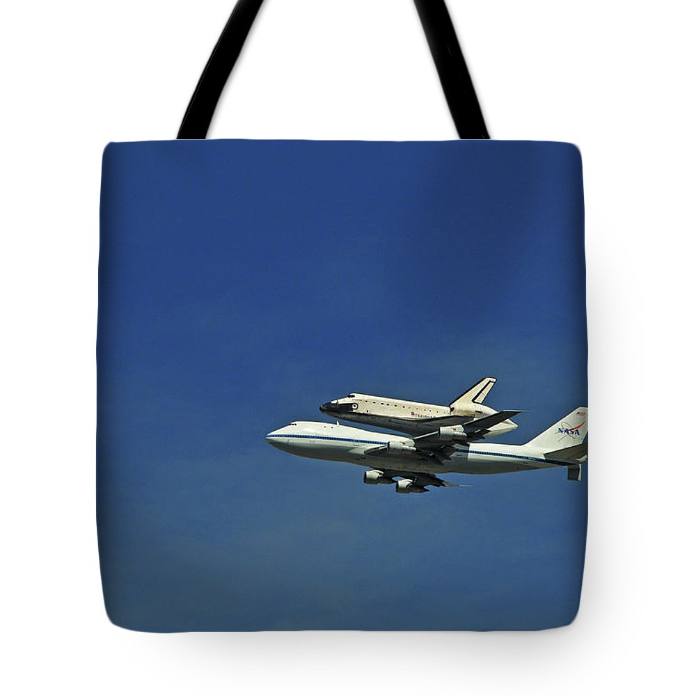 Teamwork Tote Bag featuring the photograph Final Flight Of The Space Shuttle by Mitch Diamond