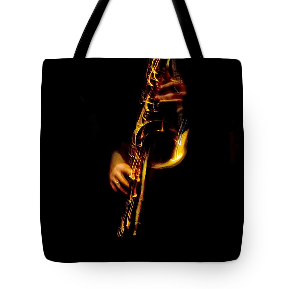 Saxaphone Tote Bag featuring the photograph Fire In The Sax by David Kay