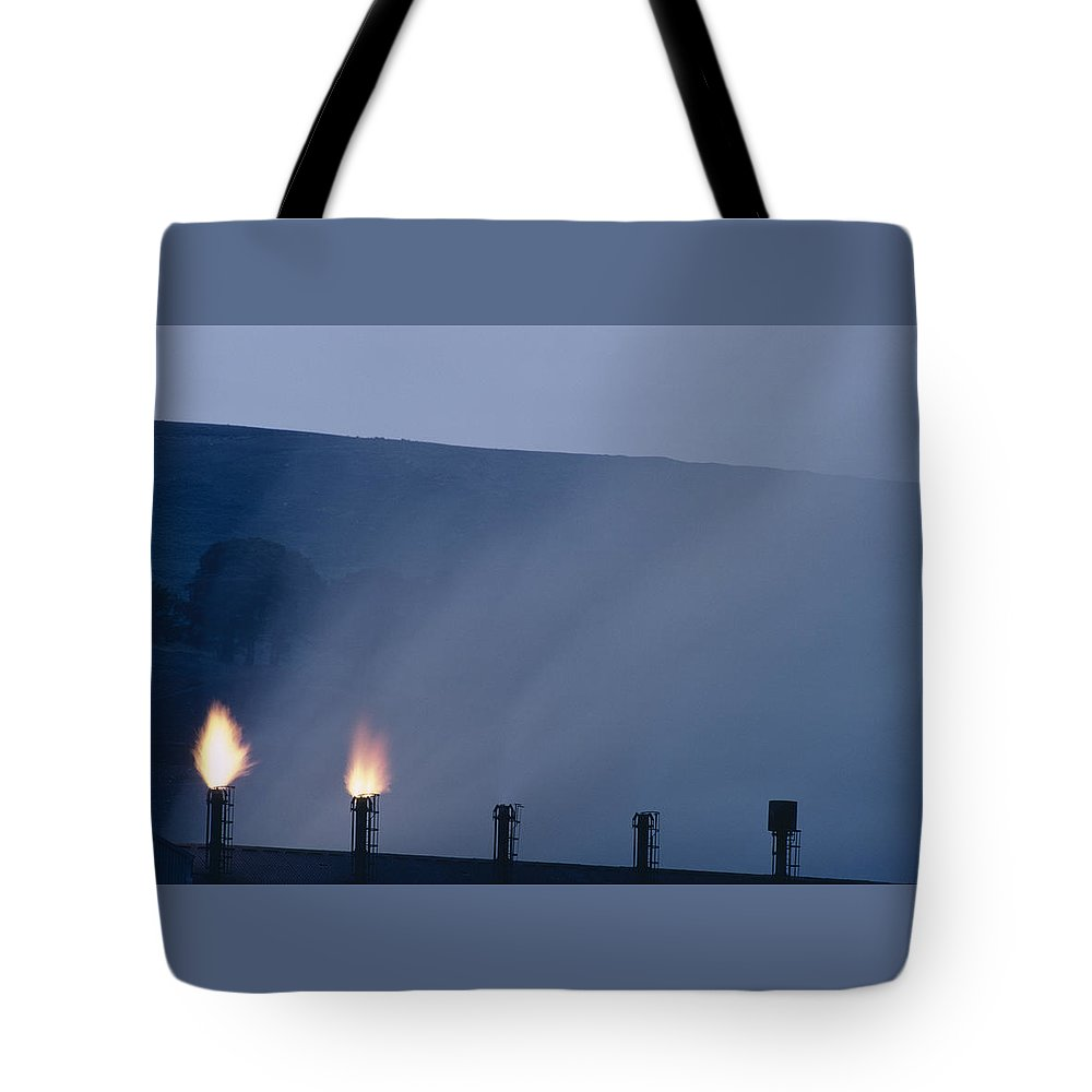 Fire Tote Bag featuring the photograph Fire by Shaun Higson