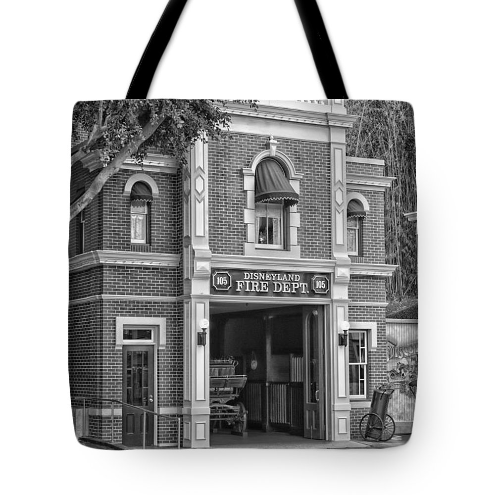 Disney Tote Bag featuring the photograph Fire Station Main Street Disneyland Bw by Thomas Woolworth