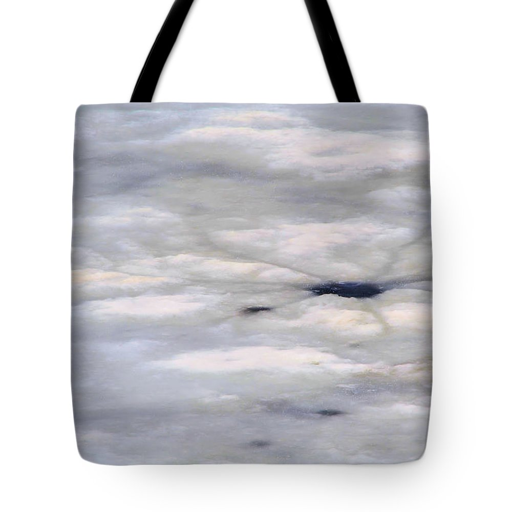 Snow Tote Bag featuring the photograph First Thaw by Nadalyn Larsen