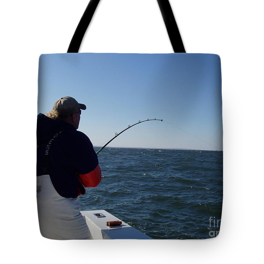 Fish Taking Line Tote Bag featuring the photograph Fish Taking Line by John Telfer
