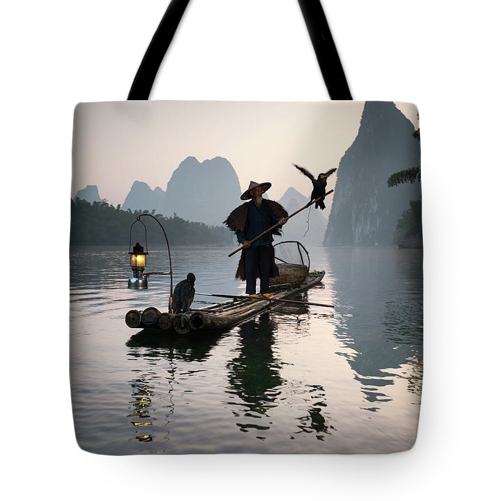 Chinese Culture Tote Bag featuring the photograph Fisherman With Cormorants On Li River by Matteo Colombo