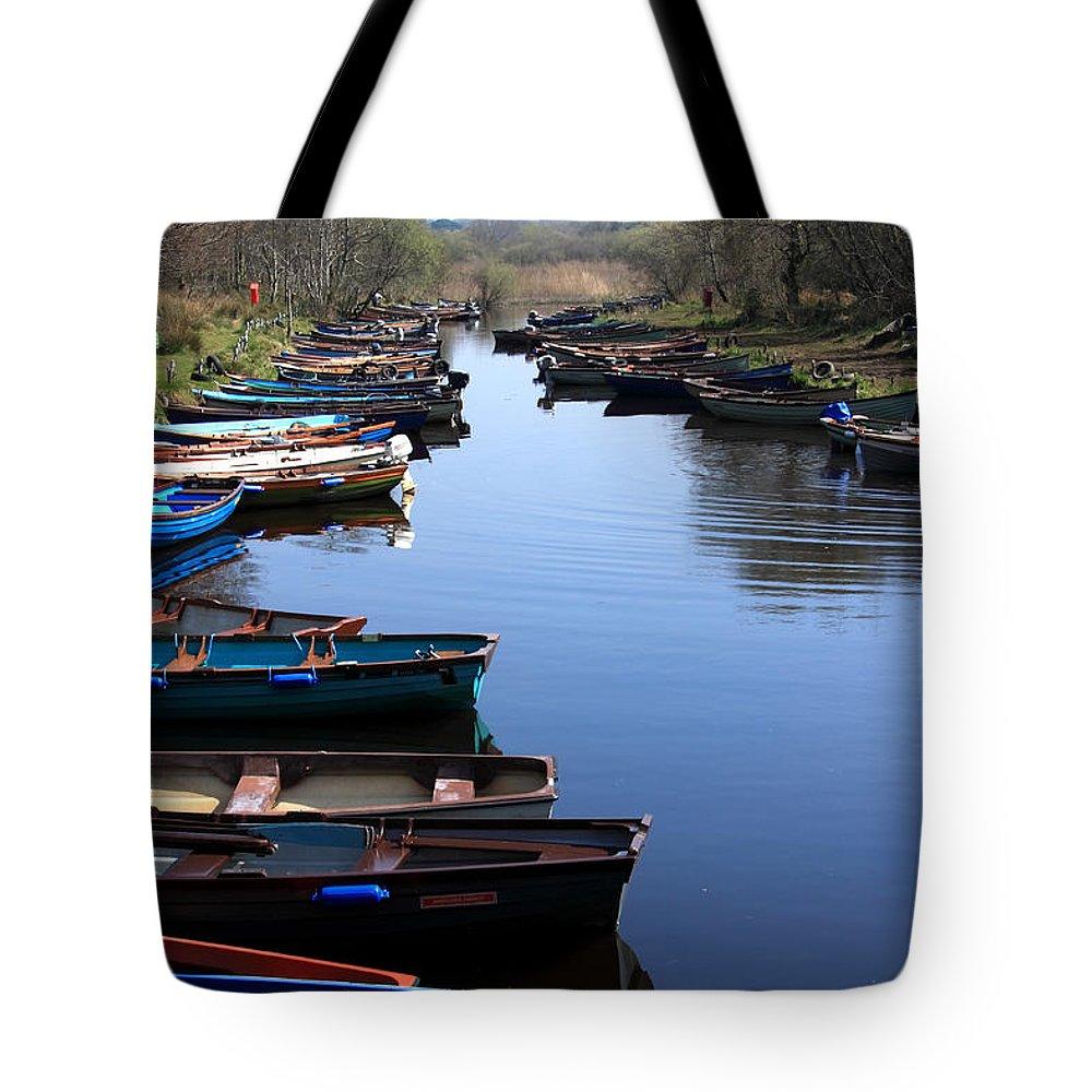 Ireland Tote Bag featuring the photograph Fishing Boat Row by Aidan Moran