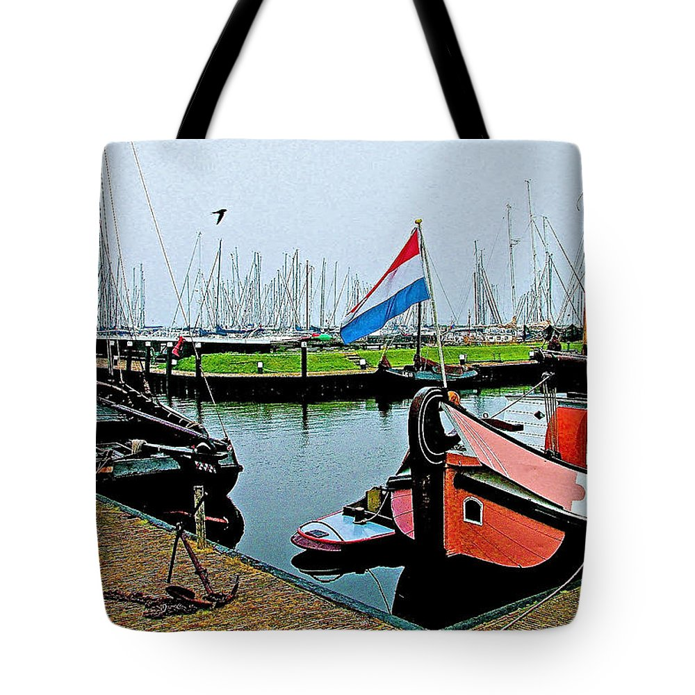 Fishing Boats In Enkhuizen Tote Bag featuring the photograph Fishing Boats In Enkhuizen-netherlands by Ruth Hager