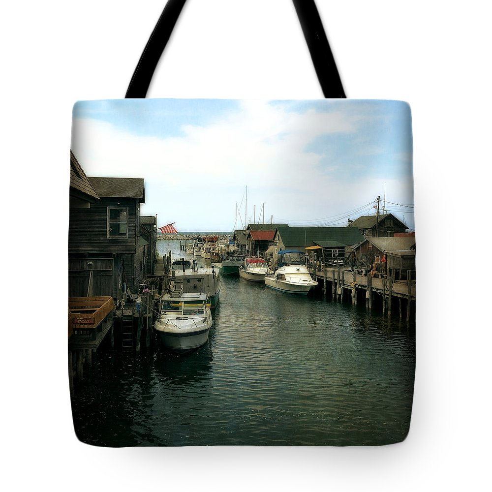 Leland Michigan Tote Bag featuring the photograph Fishing Boats In Fishtown by Michelle Calkins
