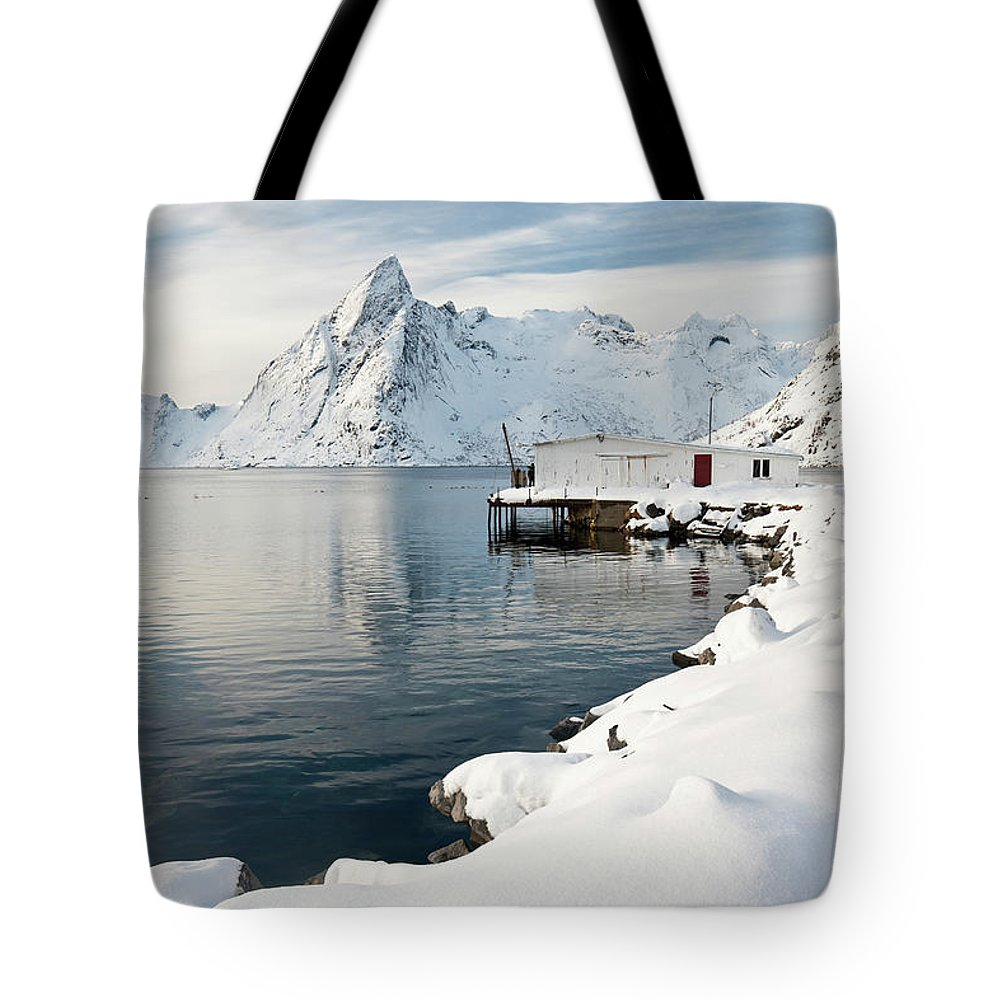Water's Edge Tote Bag featuring the photograph Fishing Lodge In Raine, Lofoten by David Clapp
