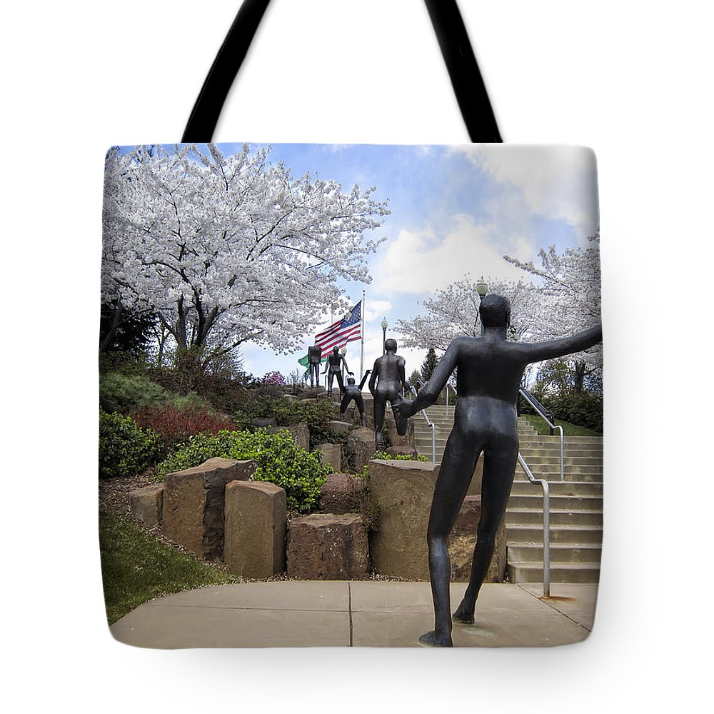 Spokane Tote Bag featuring the photograph Fleeting Spring At The Arena by Daniel Hagerman