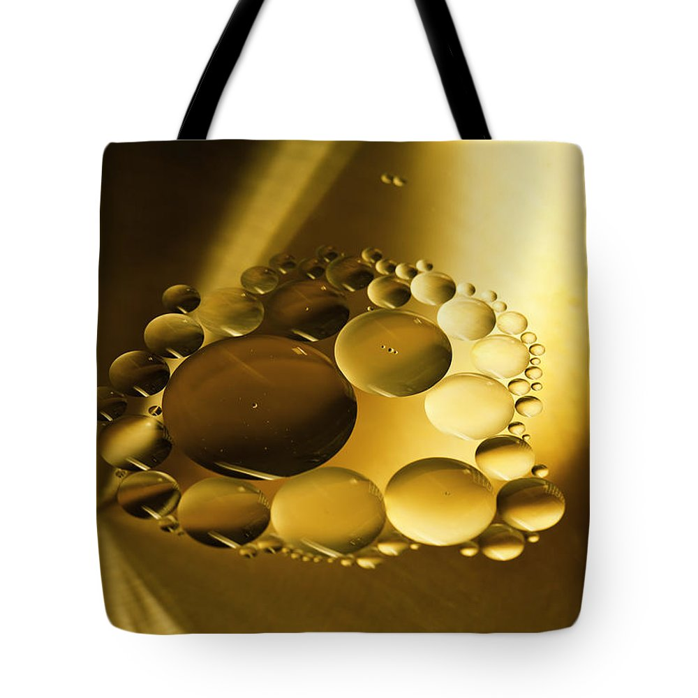 Oil Tote Bag featuring the photograph Floating Beauty by Angela Stanton