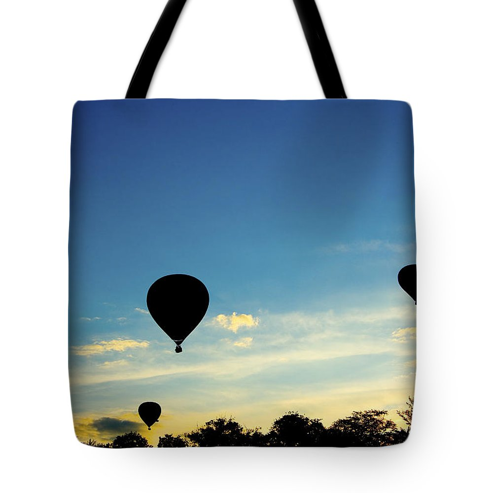 Hot Tote Bag featuring the photograph Floating In The Air At Sundown by Peter Lloyd