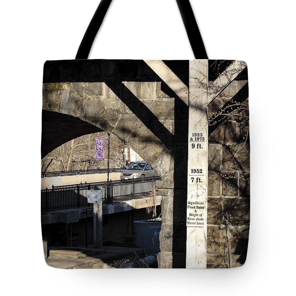 Ellicott City Tote Bag featuring the photograph Flood Height Sign At Ellicott City Maryland by William Kuta