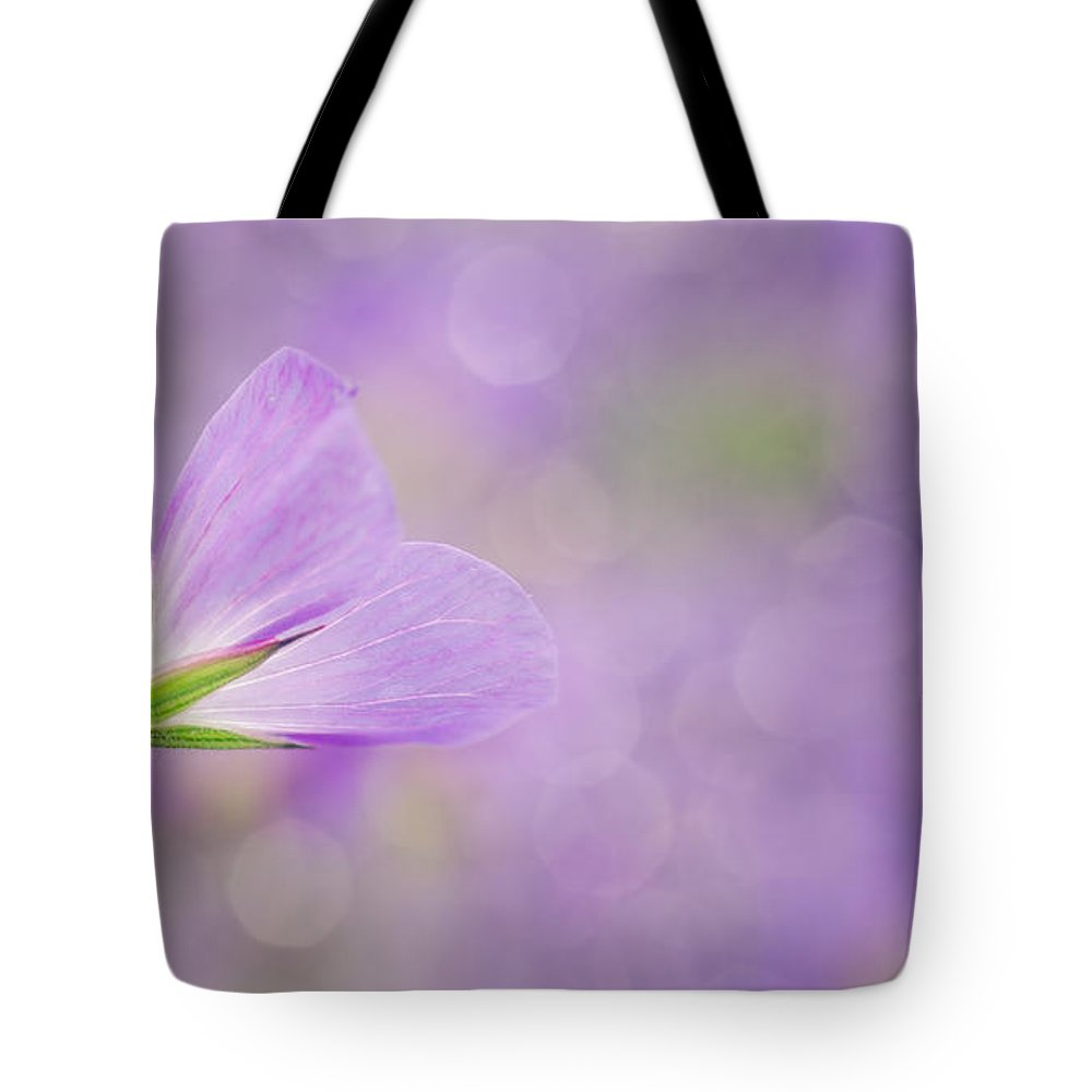 Flower Tote Bag featuring the photograph Floral Design by TouTouke A Y