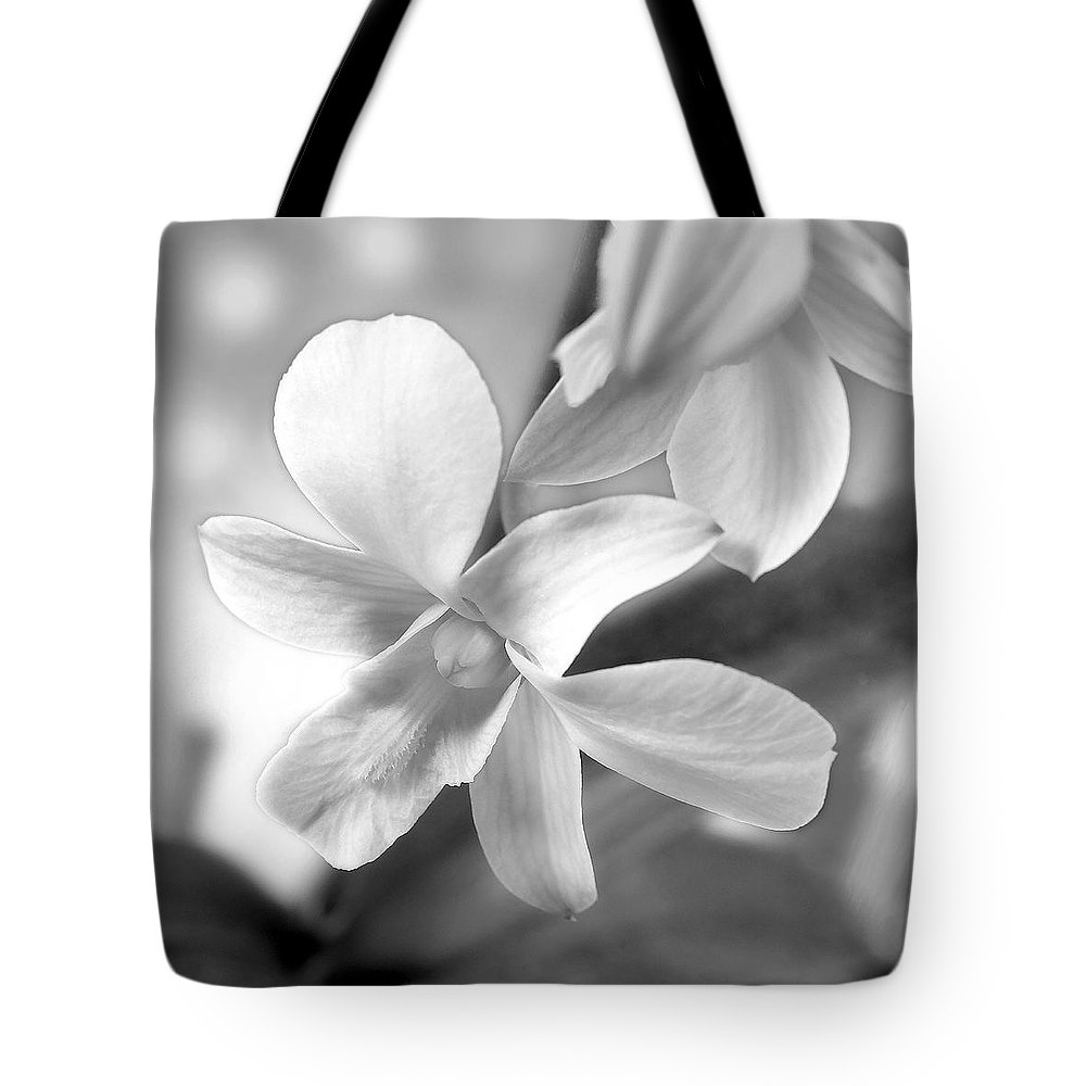 White Orchid Tote Bag featuring the photograph White Orchid by Mike McGlothlen
