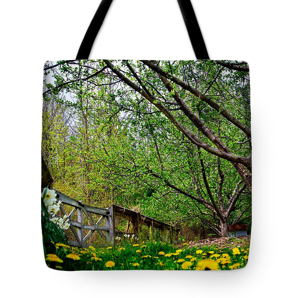 Michigan Tote Bag featuring the photograph Flowers And Fence by John McGraw