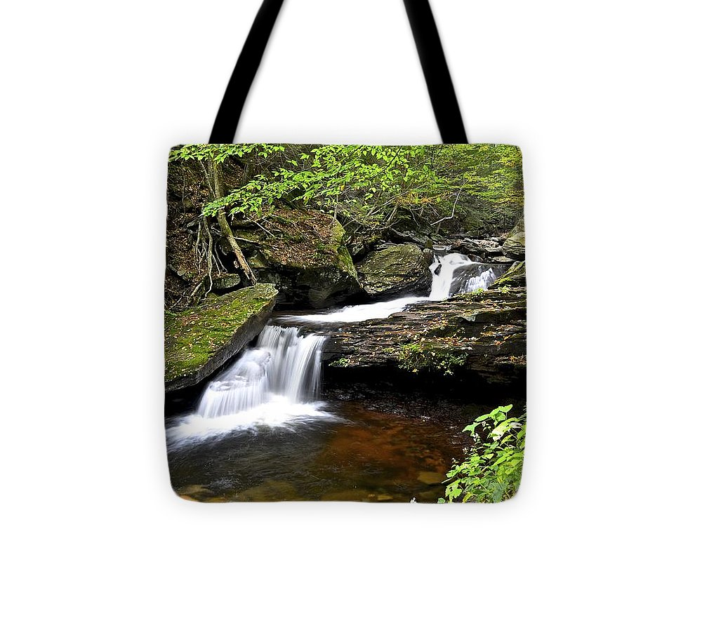 Waterfall Tote Bag featuring the photograph Flowing Falls by Frozen in Time Fine Art Photography
