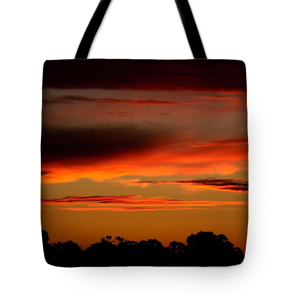 Sunset Tote Bag featuring the photograph Fluorescent Sunset by Mark Blauhoefer
