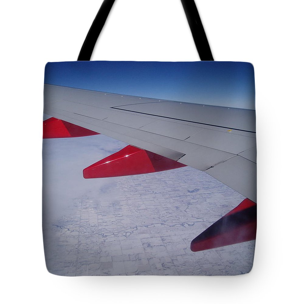 Red Tote Bag featuring the photograph Fly Away With Me by Jennifer E Doll