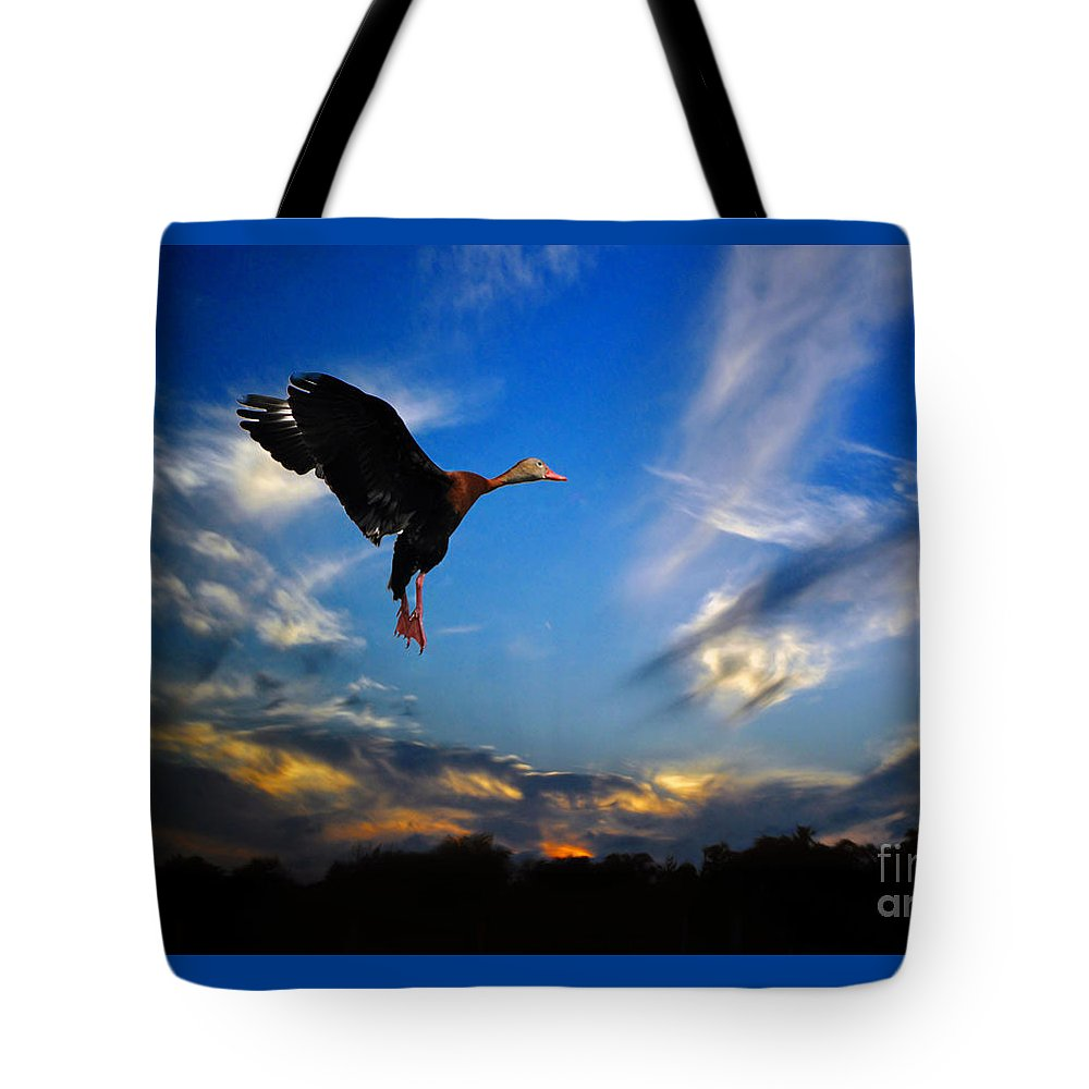 Flying Tote Bag featuring the photograph Flying Duck by Savannah Gibbs