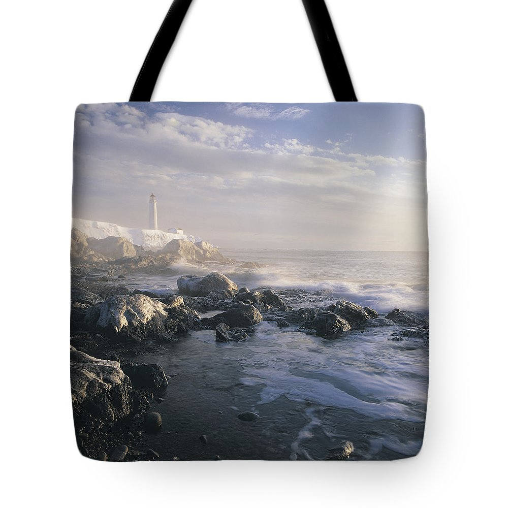 Light Tote Bag featuring the photograph Fog And Rocky Shoreline In Winter With by Claude Bouchard