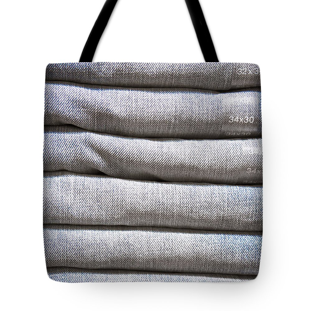 Apparel Tote Bag featuring the photograph Folded Denim by Tom Gowanlock