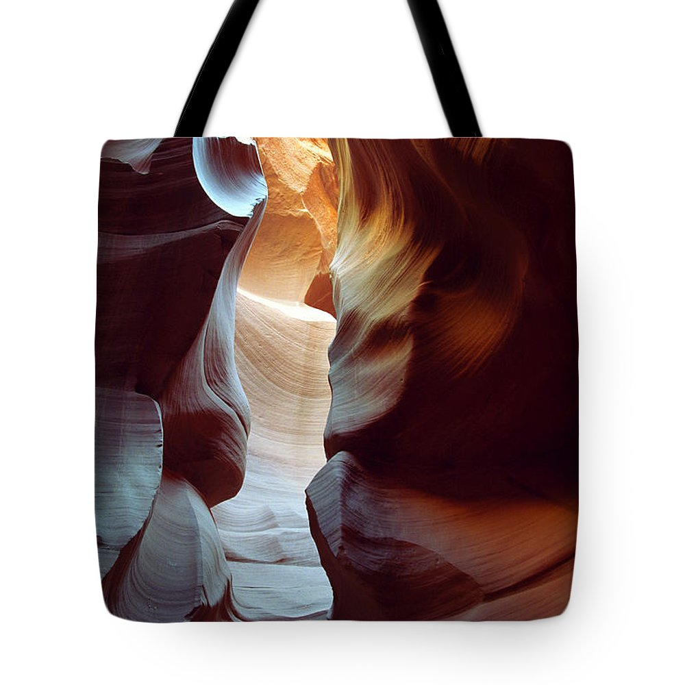 Slot Canyon Tote Bag featuring the photograph Follow The Light II by Kathy McClure