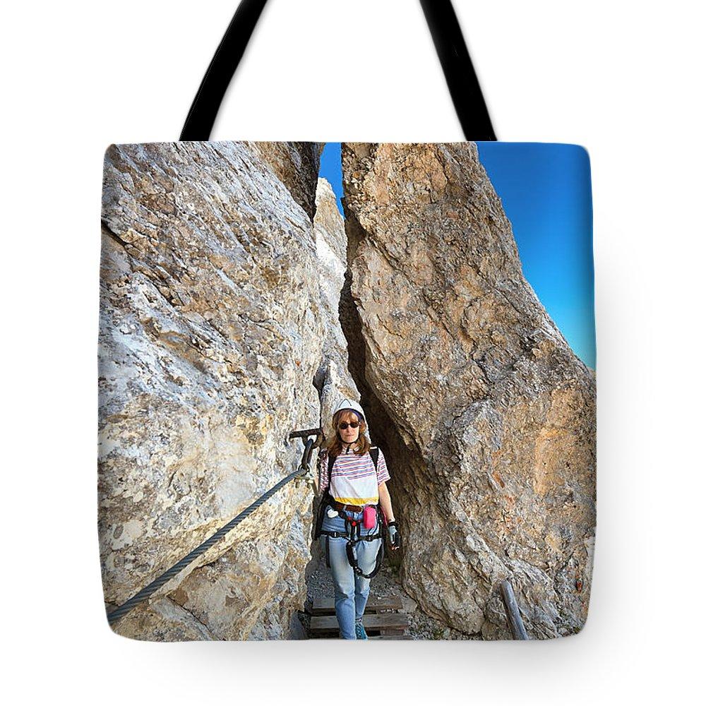 Alpine Tote Bag featuring the photograph Footbridge On Via Ferrata by Antonio Scarpi