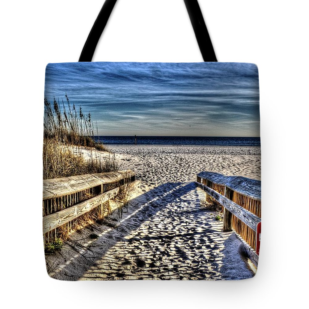 Sand Tote Bag featuring the photograph Footprint's In The Sand by Paul Lindner