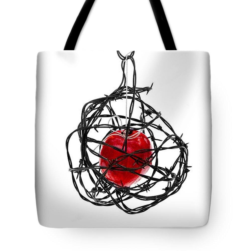 Cage Tote Bag featuring the photograph Forbidden Fruit by Aaron Aldrich