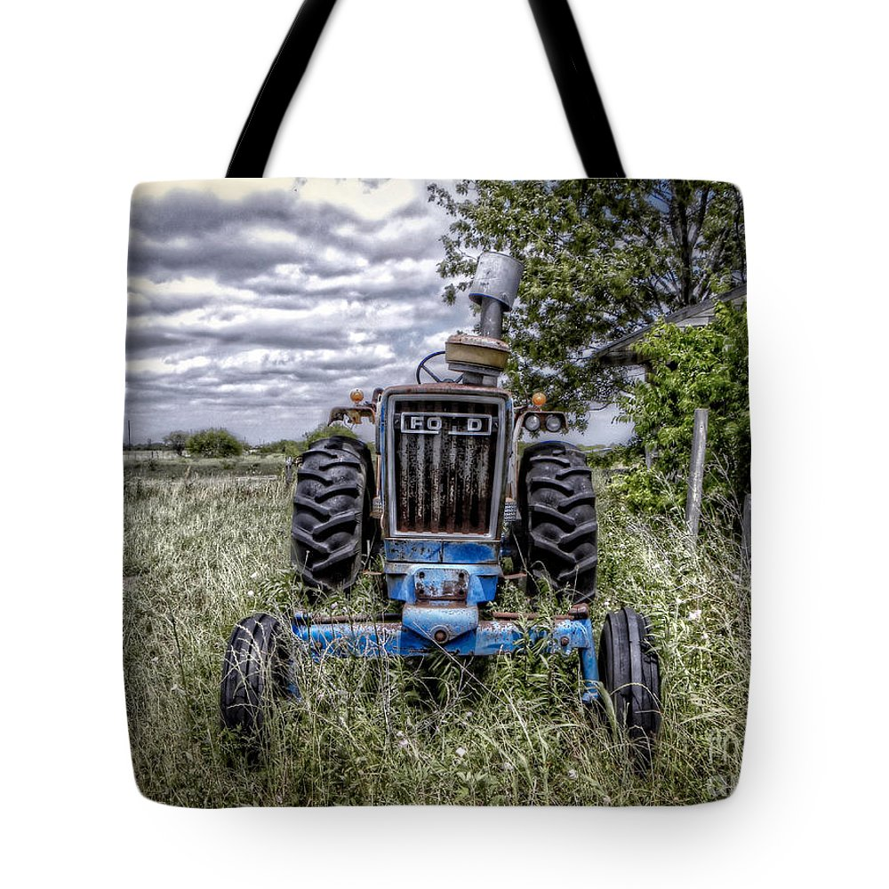 Ford Tote Bag featuring the photograph Ford by Savannah Gibbs