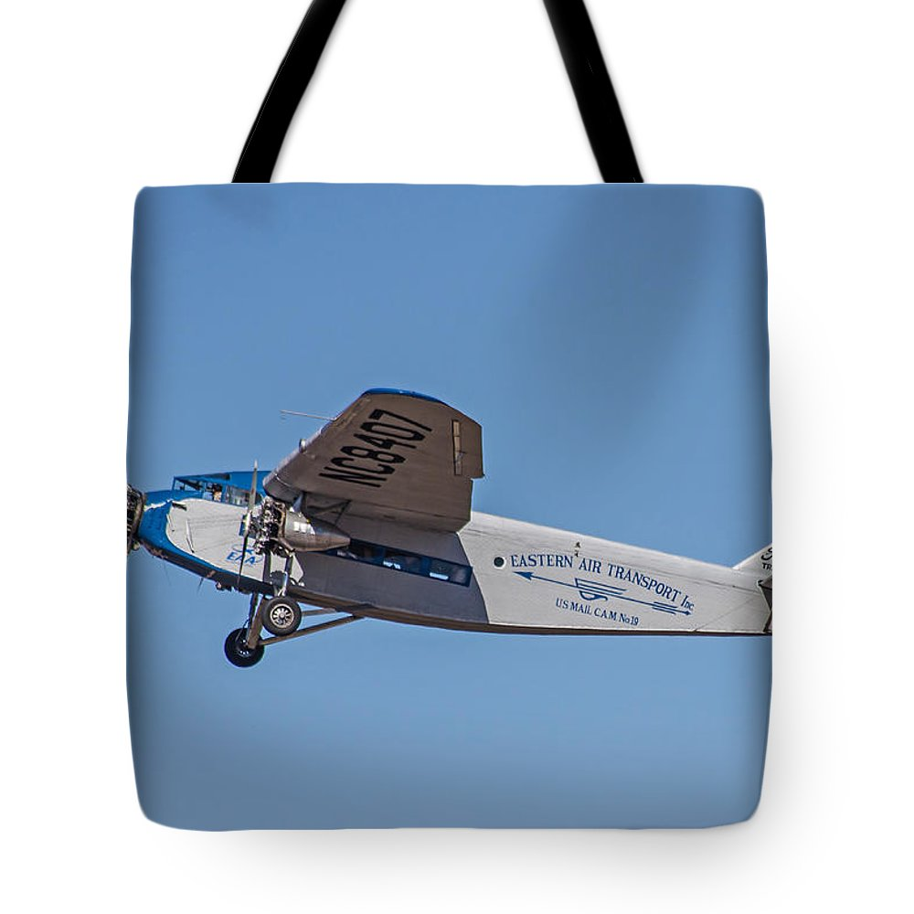Airplane Tote Bag featuring the photograph Ford Tri-motor In Flight by Allen Sheffield