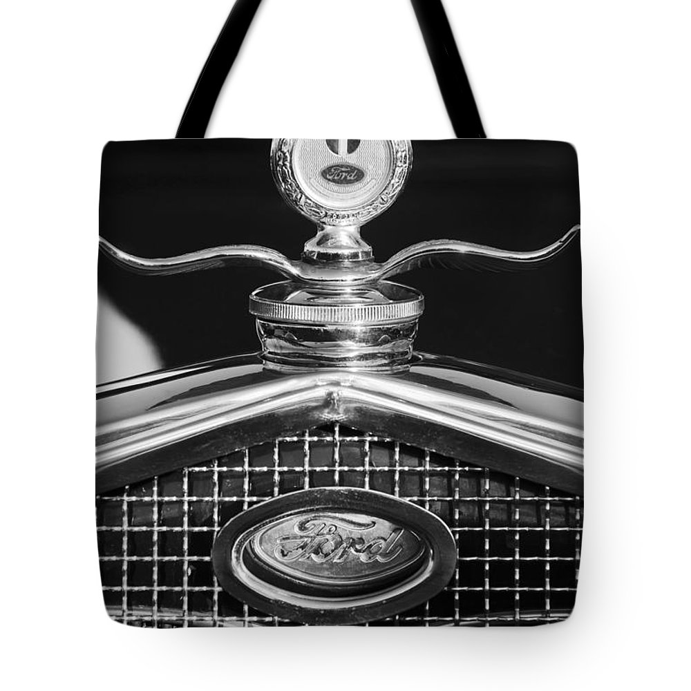 Ford Motometer Tote Bag featuring the photograph Ford Winged Hood Ornament Black And White by Jill Reger