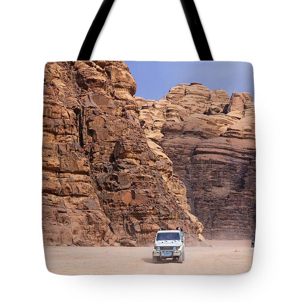 Jordan Tote Bag featuring the photograph Four Wheel Drive Vehicles At Wadi Rum Jordan by Robert Preston