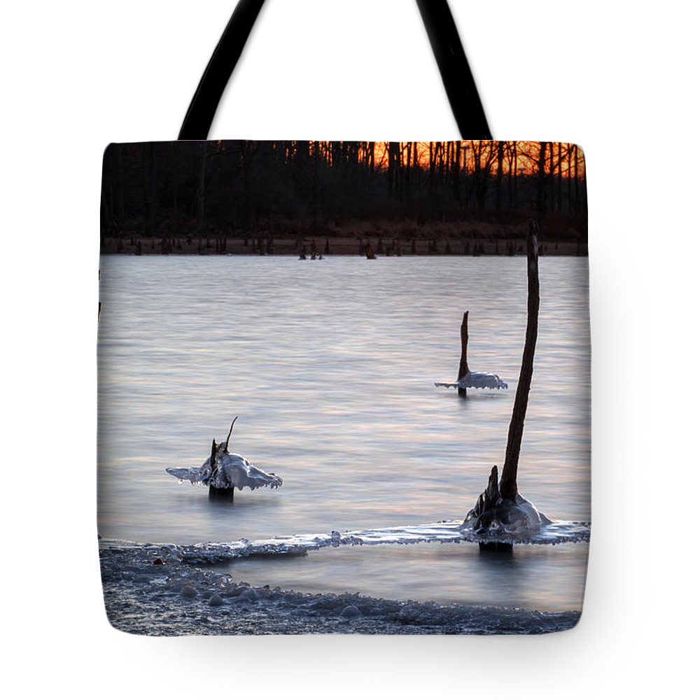Ice Tote Bag featuring the photograph Freezing Lake by Thomas Sellberg