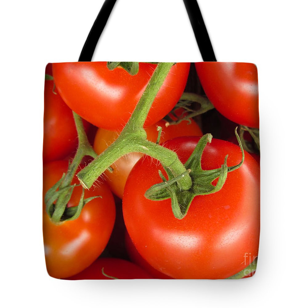 Tomato Canvas Print Tote Bag featuring the photograph Fresh Whole Tomatos On Vine by David Millenheft
