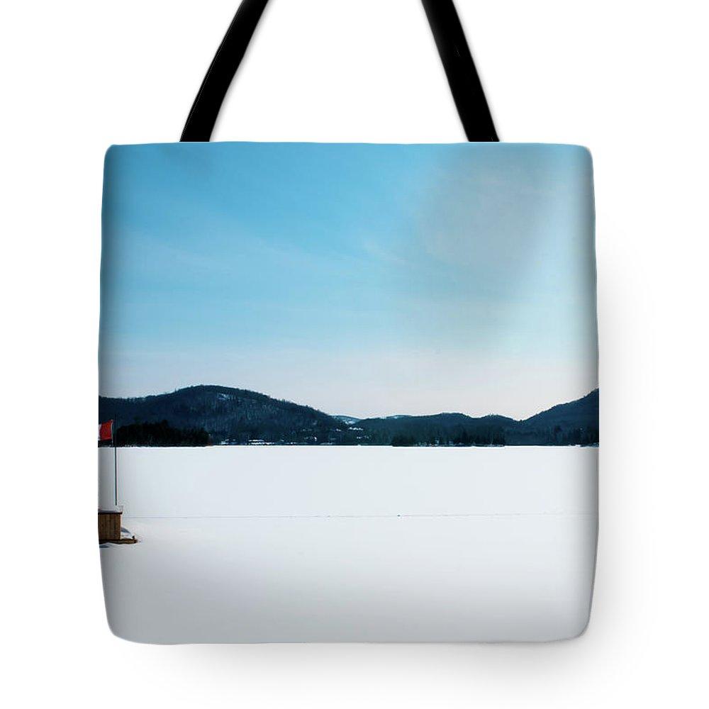 Scenics Tote Bag featuring the photograph Frozen Lake In Canada by Haja Rasambainarivo