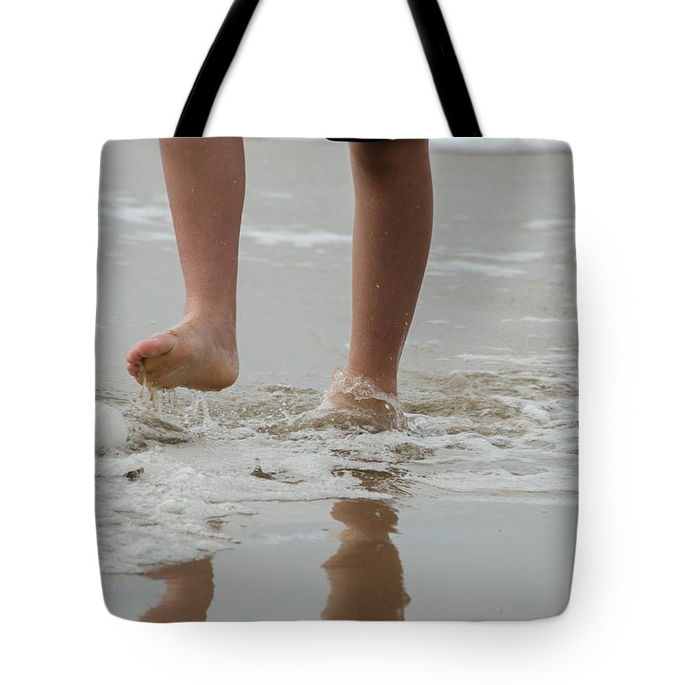 Kid Tote Bag featuring the photograph Fun In The Surf by Joie Cameron-Brown