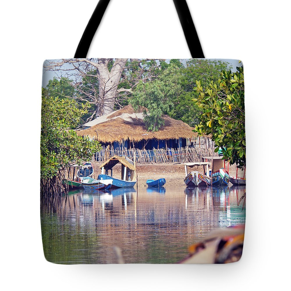 The Gambia Tote Bag featuring the photograph Gambian Fishing Village by Tony Murtagh