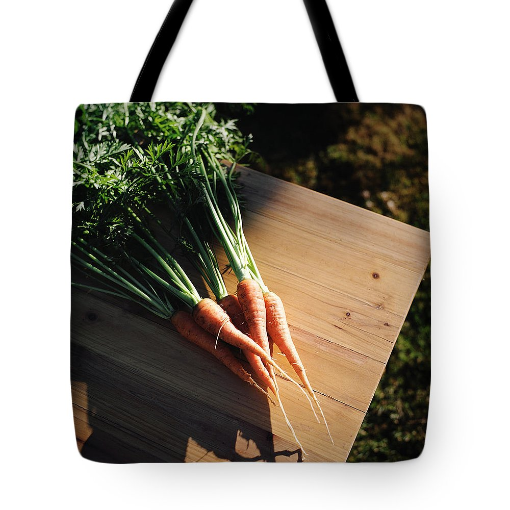 Five Objects Tote Bag featuring the photograph Garden Carrots On Sunny Stool by Danielle D. Hughson