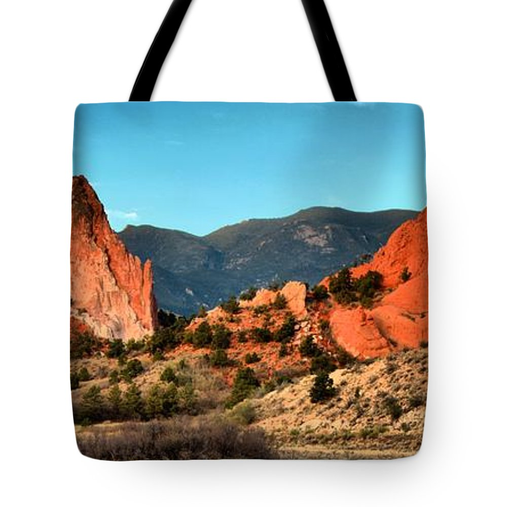 Sunrise At Garden Of The Gods Tote Bag featuring the photograph Garden Of The Gods Sunrise Panorama by Adam Jewell
