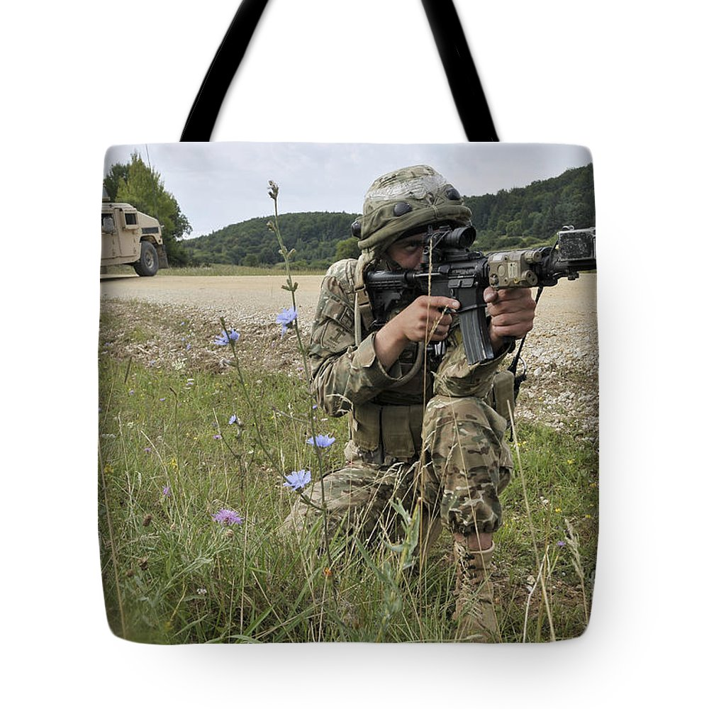 Germany Tote Bag featuring the photograph Georgian Army Sergeant Aims An M4 by Stocktrek Images