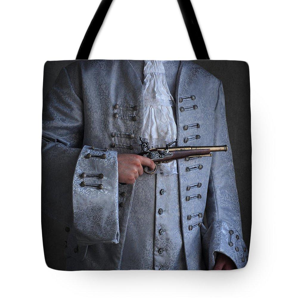 Georgian Tote Bag featuring the photograph Georgian Gentleman Holding A Flintlock Pistol by Lee Avison