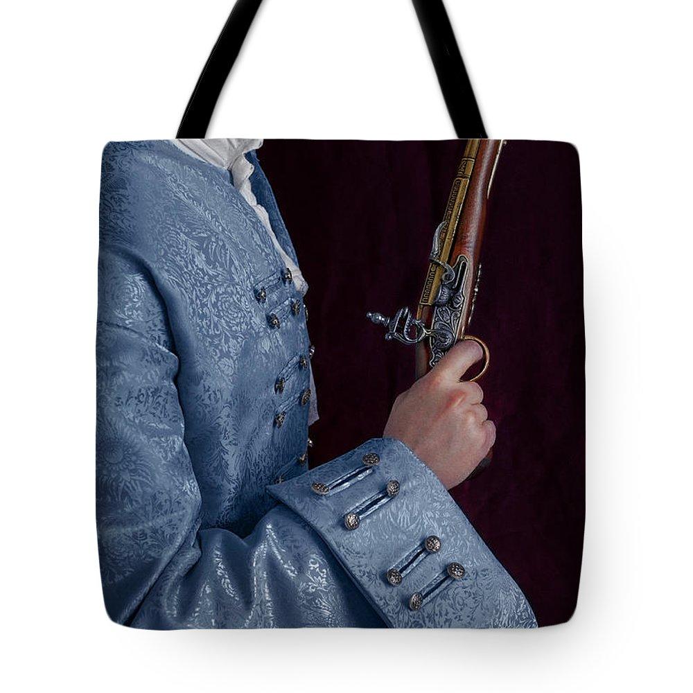Georgian Tote Bag featuring the photograph Georgian Man Holding A Flintlock Pistol by Lee Avison