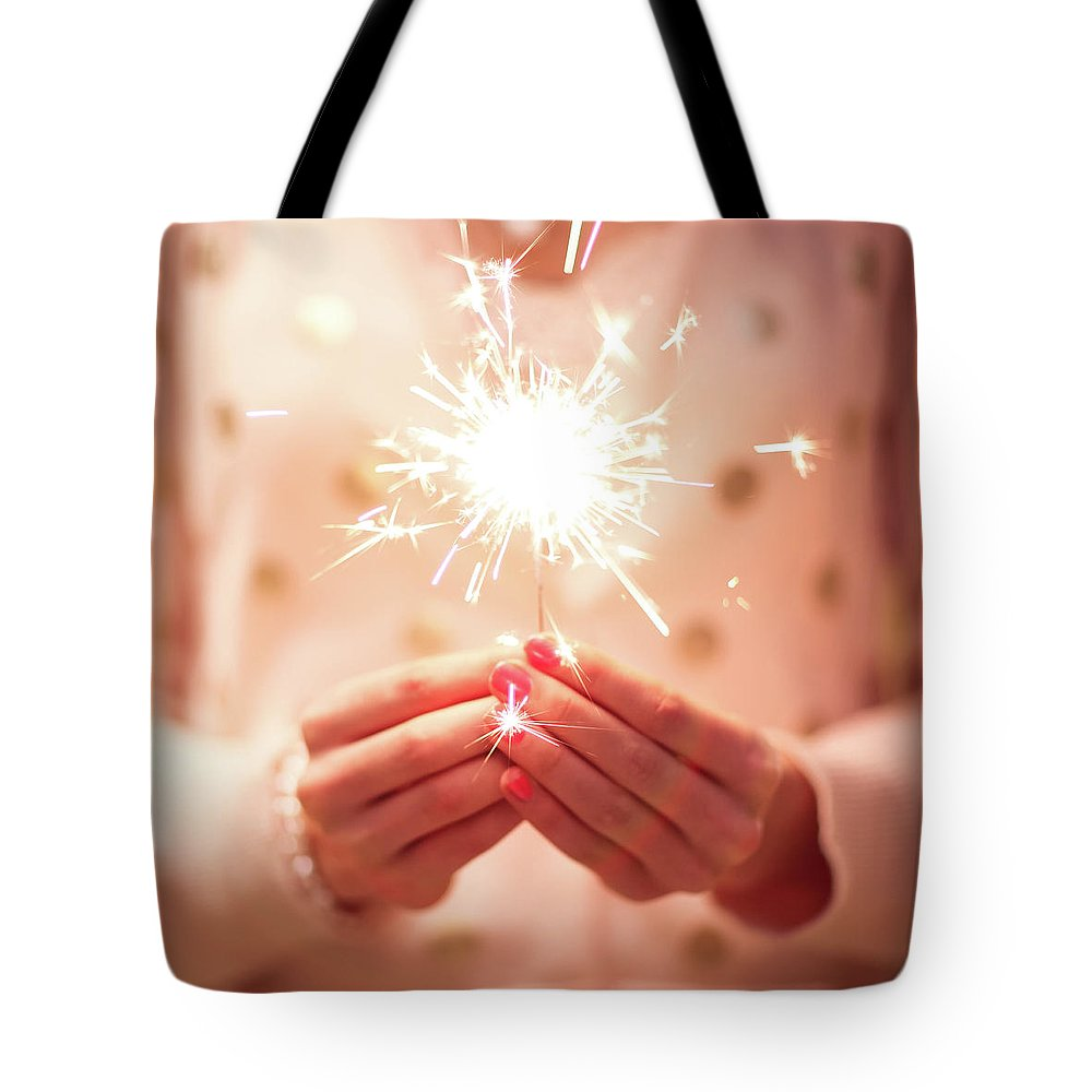 Firework Display Tote Bag featuring the photograph Girl Holding Small Sparkler by Sasha Bell