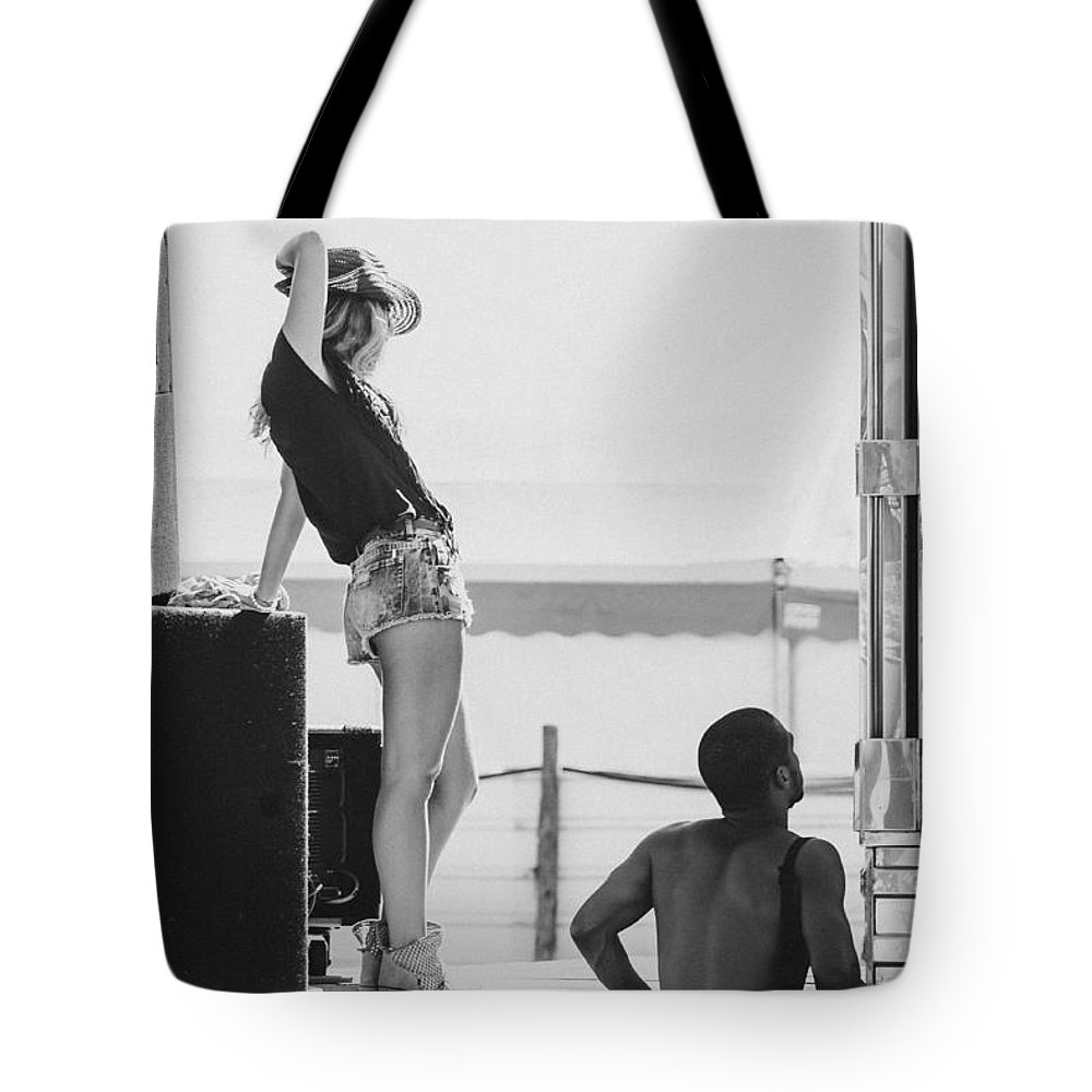 Cowgirl Tote Bag featuring the photograph Girl In A Cowboy Hat by Marco Oliveira