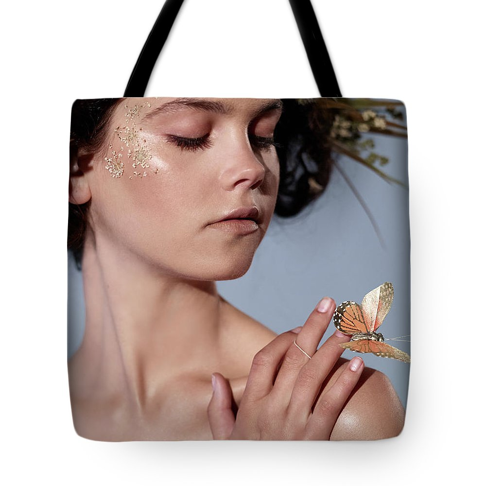 Tranquility Tote Bag featuring the photograph Girl With Butterfly In Hand by Bill Diodato