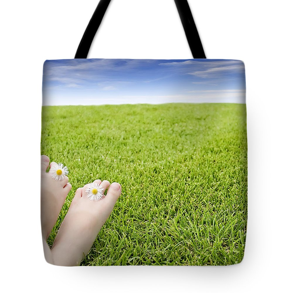 Light Tote Bag featuring the photograph Girls Feet On Grass With Flowers by Vast Photography
