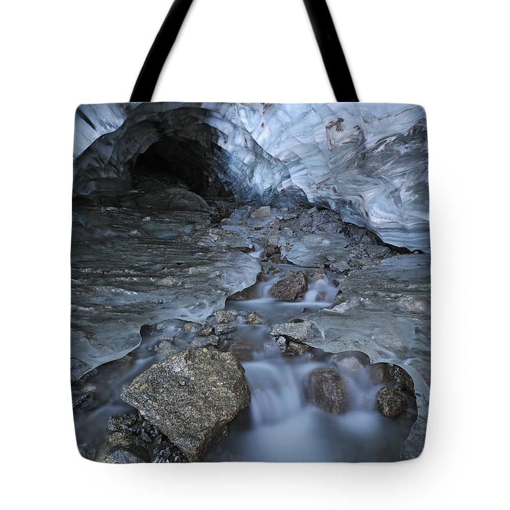 Light Tote Bag featuring the photograph Glacial Creek Flowing From Blue Ice by Peter Mather