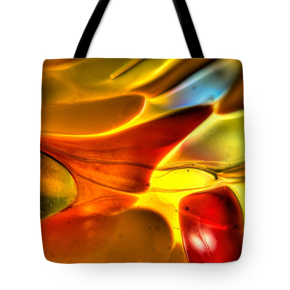 Colored Tote Bag featuring the photograph Glass And Light by Charles Hite