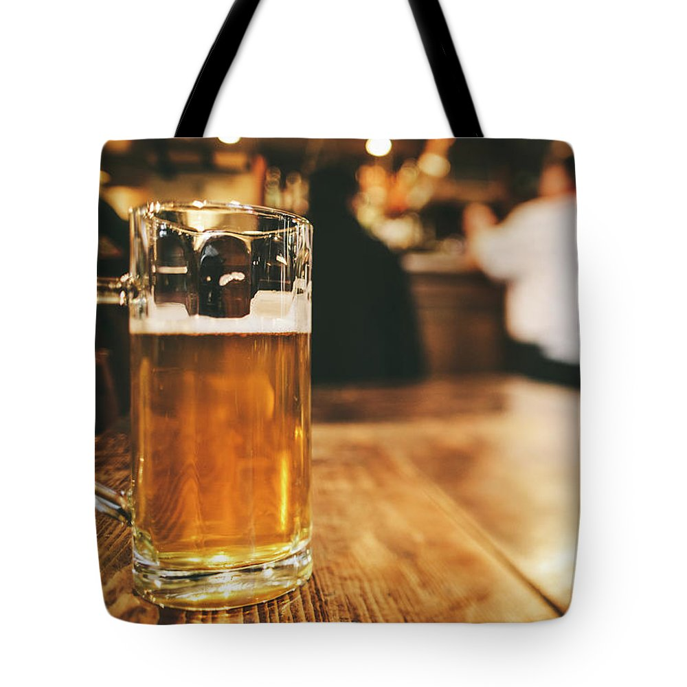 Alcohol Tote Bag featuring the photograph Glass Of Bier, Brewery In Germany by Moreiso
