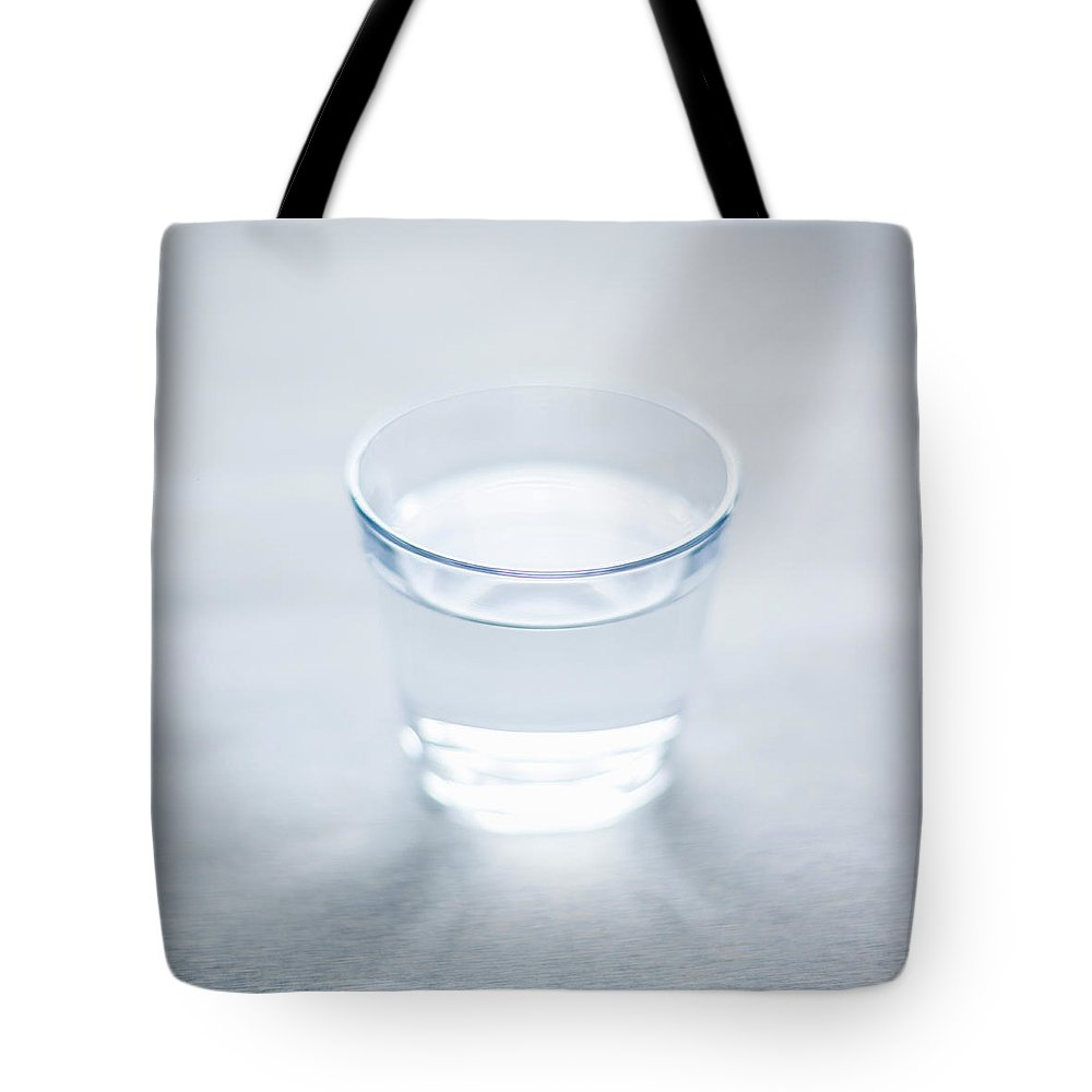 White Background Tote Bag featuring the photograph Glass Of Water by Steven Errico
